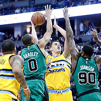 10 March 2017: Denver Nuggets forward Nikola Jokic (15) goes for the baby hook over Boston Celtics guard Avery Bradley (0) and Boston Celtics forward Amir Johnson (90) during the Denver Nuggets 119-99 victory over the Boston Celtics, at the Pepsi Center, Denver, Colorado, USA.