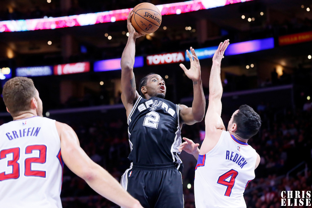 10 November 2014: San Antonio Spurs forward Kawhi Leonard (2) goes for the skyhook over Los Angeles Clippers guard J.J. Redick (4) during the San Antonio Spurs 89-85 victory over the Los Angeles Clippers, at the Staples Center, Los Angeles, California, USA.