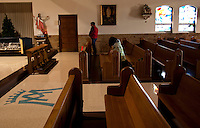 "CHAMPION, WI - DECEMBER 22: Visitors pray in the church at the Shrine of Our Lady of Good Help in a small rural town in northern Wisconsin, December 22, 2010 in Champion, Wisconsin. After years of research, the Bishop of Green Bay determined that the sightings of Mary ""clothed in dazzling white"" are indeed ""worthy of belief"" and now have now been officially sanctioned as real by the Vatican. This shrine is the first of such for the United States and now joins the company of Lourdes and Fatima.   (Darren Hauck )"