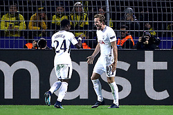 Tottenham Hotspur's Harry Kane (right) celebrates scoring his side's first goal of the game