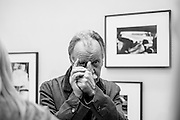 "HAMBURG, GERMANY - OCTOBER 24, 2014: German photography historian and curator Hans-Michael Koetzle at the opening of his exhibition ""Augen Auf! - 100 Years Leica"" at the Deichtorhallen, Hamburg."