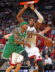 November 28, 2016 - Miami, FL, USA - The Miami Heat's Hassan Whiteside tries to guard the Boston Celtics' Isaiah Thomas as he passes the ball in the first quarter on Monday, Nov. 28, 2016 at the AmericanAirlines Arena in Miami, Fla. (Credit Image: © Charles Trainor Jr/TNS via ZUMA Wire)