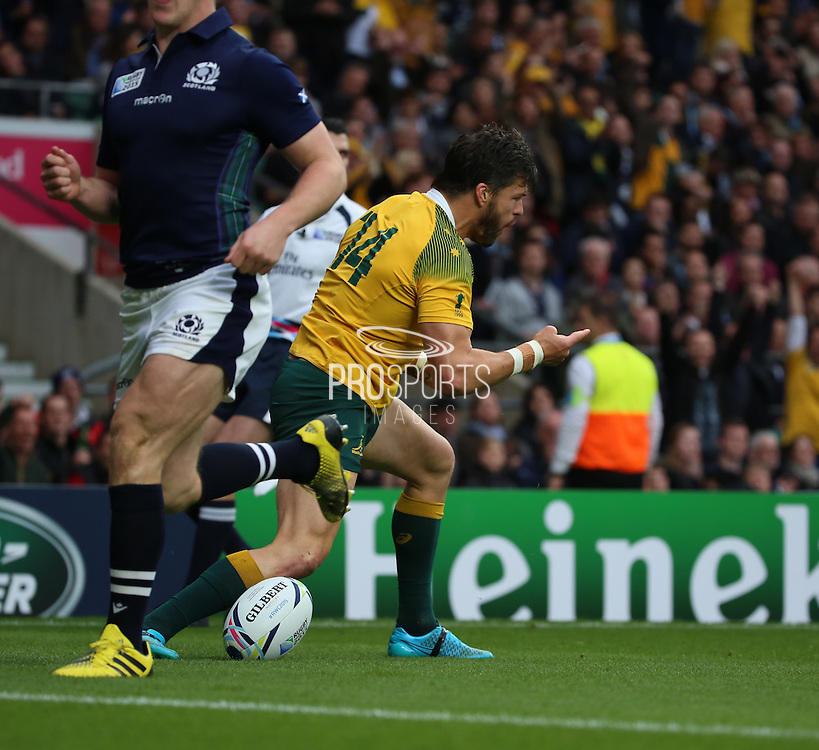 Australia's Adam Ashley-Cooper celebrating scoring the first try of the game taking the score 5 - 0 during the Rugby World Cup Quarter Final match between Australia and Scotland at Twickenham, Richmond, United Kingdom on 18 October 2015. Photo by Matthew Redman.