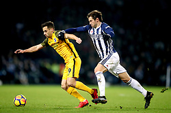 Brighton & Hove Albion's Sam Baldock (left) and West Bromwich Albion's Grzegorz Krychowiak battle for the ball during the Premier League match at The Hawthorns, West Bromwich.