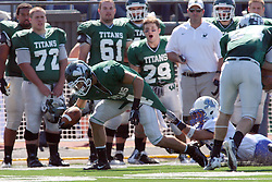 17 September 2011: Brett Robinson drags Brandon Trujillo dow the sidelines with him after catching a pass during an NCAA Division 3 football game between the Aurora Spartans and the Illinois Wesleyan Titans on Wilder Field inside Tucci Stadium in.Bloomington Illinois.