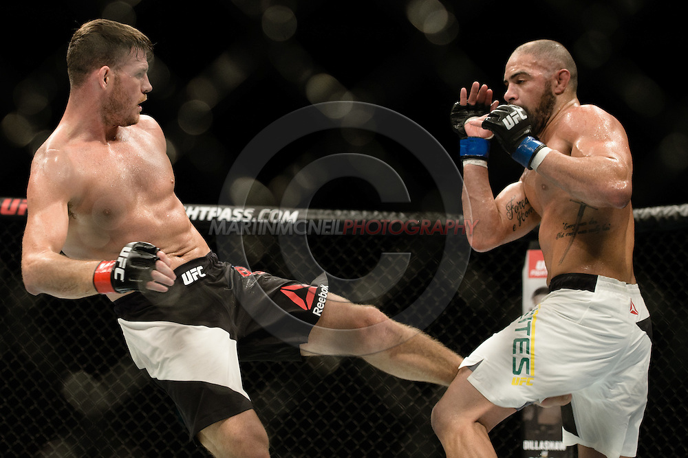"GLASGOW, SCOTLAND, JULY 18, 2015: Michael Bisping (black shorts with white stripe) defeats Thales Leites by split decision during ""UFC Fight Night 72: Bisping vs. Leites"" inside the SSE Hydro Arena in Glasgow, Scotland (Martin McNeil for ESPN)"
