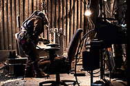 Pacific Steel Casting Company employee performs final welding on parts