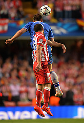 30.04.2014, Stamford Bridge, London, ENG, UEFA CL, FC Chelsea vs Atletico Madrid, Halbfinale, Rueckspiel, im Bild Chelsea's defender Branislav Ivanovic and Athletico Madrid's midfielder Arda Turan compete for the ball // Chelsea's defender Branislav Ivanovic and Athletico Madrid's midfielder Arda Turan compete for the ball during the UEFA Champions League Round of 4, 2nd Leg Match between Chelsea FC and Club Atletico de Madrid at the Stamford Bridge in London, Great Britain on 2014/05/01. EXPA Pictures © 2014, PhotoCredit: EXPA/ Mitchell Gunn<br /> <br /> *****ATTENTION - OUT of GBR*****