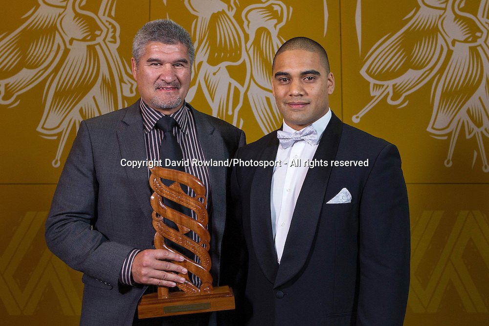 Maori Sports Team was awarded to the Maori All Blacks with coach Colin Cooper (L) receiving the trophy from Ashar Gunn at the Maori Sports Awards 2014, Vodafone Events Centre, Manukau, Auckland, New Zealand, Saturday, November 29, 2014. Photo: David Rowland/Photosport