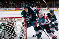 KELOWNA, CANADA - FEBRUARY 2: Kyle Topping #24 of the Kelowna Rockets checks Riley Sutter #14 in front of the net Carter Hart #70 of the Everett Silvertips  on FEBRUARY 2, 2018 at Prospera Place in Kelowna, British Columbia, Canada.  (Photo by Marissa Baecker/Shoot the Breeze)  *** Local Caption ***