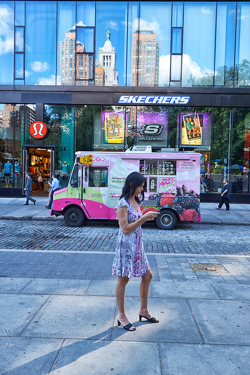 Woman texting, Union Square,New York, USA<br /> Model release 0345