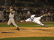 Lexington Legends catcher Hector Gimenez,37, lunges for Greensboros Dioner Navarro who scored the go ahead run  in the top of the 11th inning  in  the LEgends  first home game on  thursday April 11, ,2002 in Lexington, Ky. Keyword: Lexington Legends and Opening day 2002
