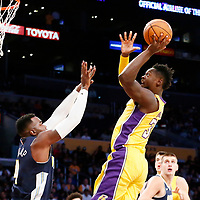 02 October 2017: Los Angeles Lakers forward Julius Randle (30) goes for the jump shot over Denver Nuggets forward Paul Millsap (4) during the Denver Nuggets 113-107 victory over the LA Lakers, at the Staples Center, Los Angeles, California, USA.