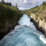 The Huka Falls are the largest falls on the Waikato River, near Taupo on New Zealand's North Island..They are the most visited natural attraction in New Zealand!.The Waikato river is one of New Zealand's longest rivers and it drains Lake Taupo - the largest freshwater lake in all of Australasia. .At the Huka Falls, the Waikato River which is normally 100m wide, is squeezed through a 20 metre wide gorge and over a 20m drop..Every second up to 220,000 litres of water gushes through the gorge and shoots out over 8 metres beyond to create a beautful blue/green pool..The name Huka is the Maori word for 'foam', which is appropriate as the falling water and rapids certainly resembles foam, especially under flooding conditions.Lake Taupo, New Zealand,, 7th January 2011.  Photo Tim Clayton.