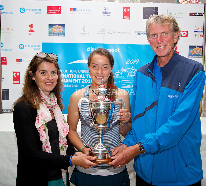 LIVERPOOL, ENGLAND - Friday, June 20, 2014: Jodie Burrage (GBR) celebrates with the trophy with her mother and coach after winning the Ladies' Singles Final beating Tara Moore (GBR) 6-4, 7-5 on Day Two of the Liverpool Hope University International Tennis Tournament at Liverpool Cricket Club. (Pic by David Rawcliffe/Propaganda)