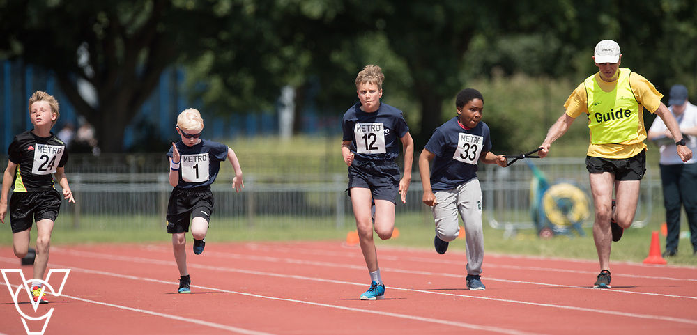 Metro Blind Sport's 2017 Athletics Open held at Mile End Stadium.  60m.  From left, Harry Hughes, Arthur Milles and Clinton Njoku with guide runner<br /> <br /> Picture: Chris Vaughan Photography for Metro Blind Sport<br /> Date: June 17, 2017