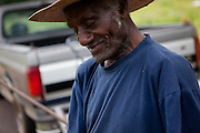 """BESSEMER, AL – APRIL 27, 2012: Blues legend Henry """"Gip"""" Gipson, 90, tends to the graveyard he owns outside of Bessemer. <br /> <br /> After an altercation with the KKK in the 60's rendered his left hand badly broken, Gipson's method of guitar playing had to change. """"I had to crowd the strings,"""" Gipson said, describing the method that he adopted. Today, Gipson operates Gip's Place, one of few true remaining juke joints in the country. """"Music don't care no color,"""" Gipson said. """"And that's why I love blues, because blues deals with a story to tell you."""""""