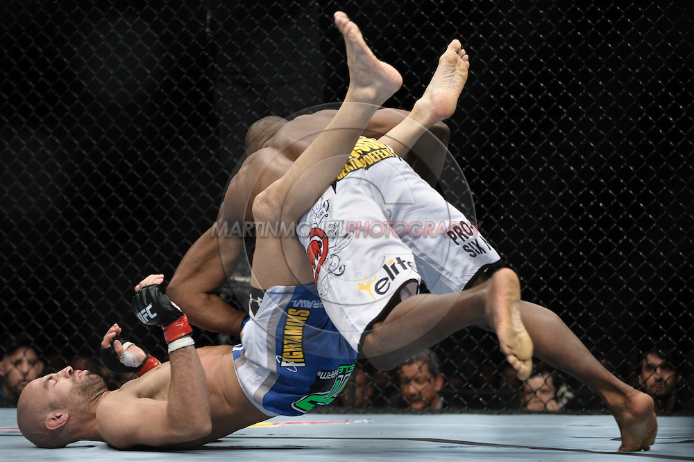 "LONDON, ENGLAND, OCTOBER 2010: James Wilks (left) tries to fend off Claude Patrick during ""UFC 120: Bisping vs. Akiyama"" inside the O2 Arena in Greenwich, London"