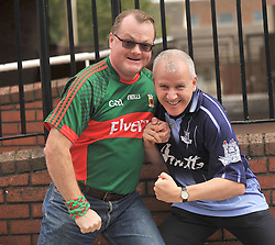Mayo fan John Linsay from Knockmore and Dubliner David Rafter line-up for round two after the All Ireland Semi-final between the two counties ended in a draw on sunday last.<br /> Pic Conor McKeown
