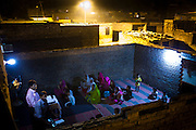 Islamabad: Worshipers at a makeshift church on the roof of an abandoned building in the Christian colony in Islamabad...Pakistan's Christian communities account for an estimated one percent of the country's 180 million population...I the middle of Islamabad's wealthiest neighbourhood is a 'colony' that's home to some 4000 Christians. Narrow alleys separate multi-storey, squalid houses with open sewers running meandering the alleys to the river that runs through the heart of the colony...Some are recent arrivals from Faisalabad and Gojra, where recent sectarian killings forced many to relocate to the relative safety of the capitol territory. Many are second and third generation residents squatting on land that sees no development assistance from the Capital Development Authority. Power outages are frequent, many residents sleep on the roofs during the long summer months, there are no air-conditioners in the colony...Many of the residents are unemployed; those fortunate to have any income usually work as servants, gardeners, drivers, security guards or cleaners. ..Discrimination against the Christian minorities is rampant in Pakistani society. Many suspect the government of deliberately keeping them at the bottom of the economic ladder to appease the radical religious parties...©JTanner/August2011