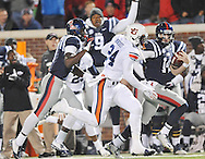 Ole Miss' quarterback Bo Wallace (14) runs down the sidelines on a long play vs. Auburn Tigers' defensive back Derrick Moncrief (24) at Vaught-Hemingway Stadium in Oxford, Miss. on Saturday, November 1, 2014. (AP Photo/Oxford Eagle, Bruce Newman)