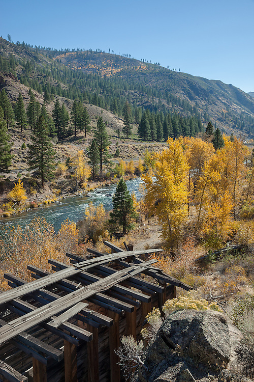 """Truckee River in Autumn 8"" - Photograph of the Truckee River, a mountain, pine trees, yellow leaved cottonwood trees and the remains of a flume in Autumn."