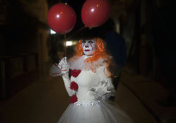 November 2, 2018 - Malaga, Spain - A woman dressed up as 'Pennywise' takes part in the IV edition of ''Churriana Noche del Terror'' (Churriana Horror Night) to celebrates the Halloween night in the neighborhood of Churriana. For this occasion, the neighborhood of Churriana decided to move the event to this night because of rainy forecast during the night of 31 october, the Hallowen Day. (Credit Image: © Jesus Merida/SOPA Images via ZUMA Wire)