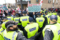 © Licensed to London News Pictures . 03/06/2017 . Liverpool , UK . EDL supporters and anti-fascists are held apart by police . Hundreds of police manage a demonstration by the far-right street protest movement , the English Defence League ( EDL ) and an demonstration by opposing anti-fascists , including Unite Against Fascism ( UAF ) . Photo credit: Joel Goodman/LNP