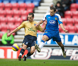 Wigan, England - Sunday, January 21, 2007: Wigan Athletic's Josip Skoko and Everton's  Leon Osman during the Premier League match at the JJB Stadium. (Pic by David Rawcliffe/Propaganda)