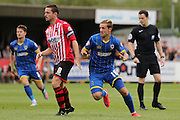 Tom Beere and Matt Oakley during the Sky Bet League 2 match between AFC Wimbledon and Exeter City at the Cherry Red Records Stadium, Kingston, England on 29 August 2015. Photo by Stuart Butcher.