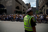 June 18, 2011, Boston, MA - Boston Police were stationed along the parade route to keep those celebrating safe. Photo by Lathan Goumas.