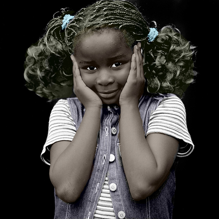 How often do we close ourselves off to the racism that exists all around us? In this powerful image, we can see that a young black girl has her hands over her ears. She is showing us what we are doing to her, and to every other POC in our neighborhoods and beyond, when we shut ourselves off to racism. This is a bold image that leaves us with the notion that we must do better. We must work harder. We must help to take some the burden away from our friends of color. Available as wall or canvas art. .<br />
