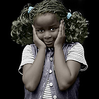 How often do we close ourselves off to the racism that exists all around us? In this powerful image, we can see that a young black girl has her hands over her ears. She is showing us what we are doing to her, and to every other POC in our neighborhoods and beyond, when we shut ourselves off to racism. This is a bold image that leaves us with the notion that we must do better. We must work harder. We must help to take some the burden away from our friends of color. Available as wall or canvas art.