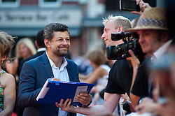 Andy Serkis signs autographs during the world premiere of Diana, in London, Thursday, 5th September 2013. Picture by Piero Cruciatti / i-Images