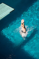 Swimmer diving into swimming pool