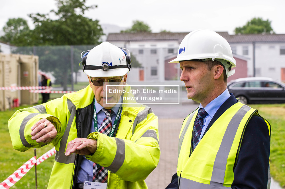 """Pictured: Contractor John  McArthur discussed the demolition with the Minister <br /> Justice Secretary Michael Matheson joined governor Caroline Johnstone to mark the start of demolition of Corton Vale Prison today. Cornton Vale is a women's prison in Stirling, operated by the Scottish Prison Service. Built in 1975, Cornton Vale comprises a total of 217 cells in its 5 houses. Ministers decided to close the prison after former Lord Advocate Elish Angiolini warned it was """"not fit for purpose"""".<br />  <br /> Ger Harley 