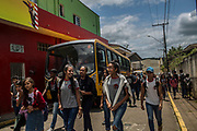 Students chat as they walk to their buses before riding back home after school in Eldorado town, south of Sao Paulo, Brazil, Tuesday, Nov. 27, 2018. (Dado Galdieri)