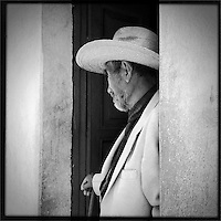 Man in cowboy hat / sombrero in a doorway in Guatemala near Lake Atitlan