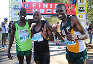 MOSSEL BAY, SOUTH AFRICA - SEPTEMBER 23: Moses Kurgat (3rd), Jari Munyarodzi (winner) and Cephas Pasimire (2nd) during the PetroSA Marathon hosted by Athletics South Western Districts (SWD) on September 23, 2017 in Mossel Bay, South Africa. (Photo by Roger Sedres/ImageSA)