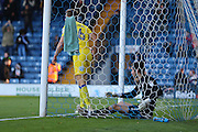 AFC Wimbledon goalkeeper James Shea (1) and AFC Wimbledon defender Paul Robinson (6) pick the ball out of the net during the The Emirates FA Cup 1st Round match between Bury and AFC Wimbledon at the JD Stadium, Bury, England on 5 November 2016. Photo by Stuart Butcher.