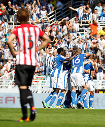 02.10.2011, Stadion Anoeta, San Sebastian Donostia, ESP, Primera Division, Real Sociedad vs Athletic Bilbao, im Bild Real Sociedad's players celebrates goal in presence of Atletic de Bilbao's Fernando Amorebieta (l) // during Primera Division football match between Real Sociedad and Athletic Bilbao at Anoeta stadium in San Sebastian Donostia, Spain on 2/10/2011. EXPA Pictures © 2011, PhotoCredit: EXPA/ Alterphoto/ Acero +++++ ATTENTION - OUT OF SPAIN/(ESP) +++++