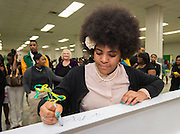Heavan Murphy writes during a beam signing ceremony at Worthing High School, December 11, 2014.