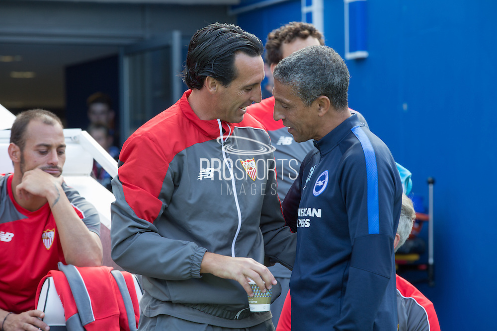 Sevilla Manager Unai Emery and Chris Hughton Manager of Brighton & Hove Albion during the Pre-Season Friendly match between Brighton and Hove Albion and Sevilla at the American Express Community Stadium, Brighton and Hove, England on 2 August 2015. Photo by Phil Duncan.