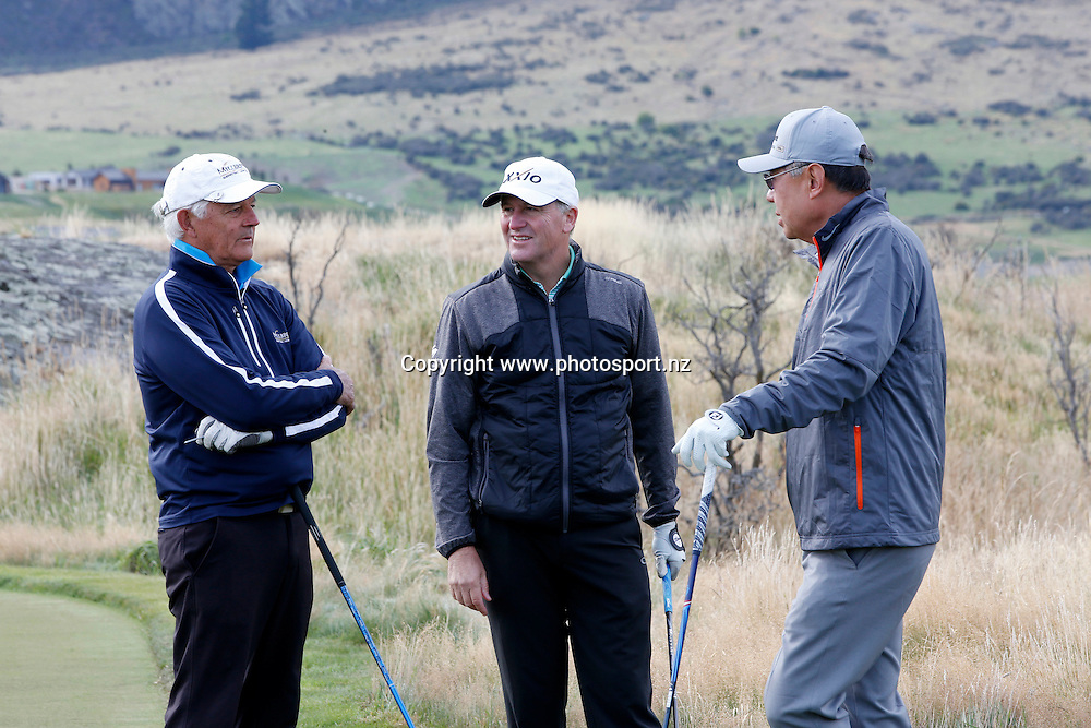 Norm Thompson,Prime Minister John Key and Roy Ryu play at Jacks Point, Queenstown, during round three of the 2016 BMW ISPS Handa New Zealand Open, The Hills, Arrowtown, New Zealand.12 March 2016. Photo by Michael Thomas/www.photosport.nz