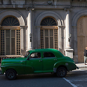 Cubans manage their daily life in the colonial city of Matanzas wether waiting in line and riding overcrowded busses or doubling up on old classic cars and motorcycles. Photography by Jose More