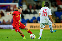 Gareth Bale of Wales (Real Madrid) is challenged by Ljubomir Fejsa of Serbia (Benfica) during the second half of the match - Photo mandatory by-line: Rogan Thomson/JMP - Tel: Mobile: 07966 386802 10/09/2013 - SPORT - FOOTBALL - Cardiff City Stadium - Cardiff -  Wales V Serbia- World Cup Qualifier.