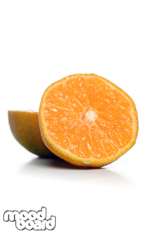 Halved mandarin on white background
