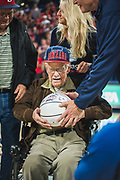 Alumnus ('52, engineering) and World War II veteran Gordon Van Scotter received the game ball at the Nov. 10 men's basketball game vs. Texas Southern. (GU photo by Gavin Doremus)