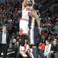 10 March 2012: Chicago Bulls power forward Carlos Boozer (5) takes a jumpshot during the Chicago Bulls 111-97 victory over the Utah Jazz at the United Center, Chicago, Illinois, USA.
