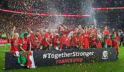 CARDIFF, WALES - Tuesday, October 13, 2015: Wales players celebrate qualifying for the finals after a 2-0 victory over Andorra during the final UEFA Euro 2016 qualifying Group B match at the Cardiff City Stadium. Jonathan Williams, Joe Allen, Joe Ledley, Gareth Bale, captain Ashley Williams. (Pic by Barry Coombs/Propaganda)